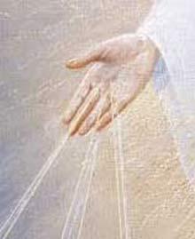 Manos de La Señora con rayos de luz